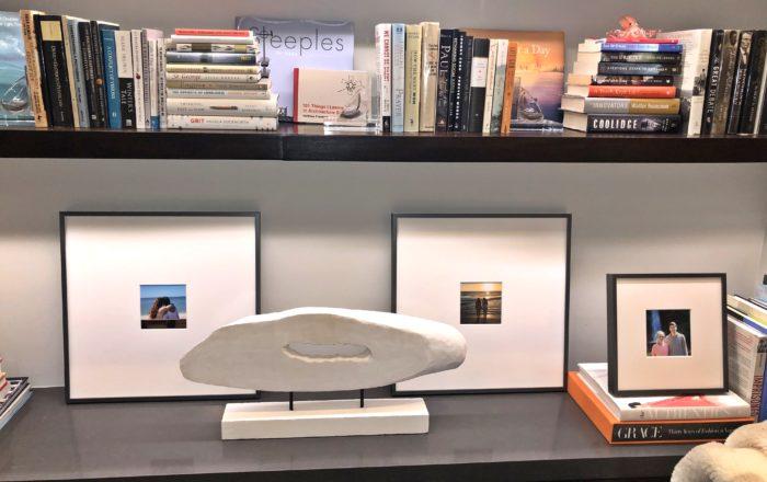 books arranged on lighted bookshelves