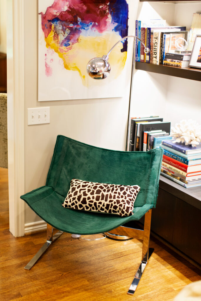 Green calf hair sling chair with leopard pillow