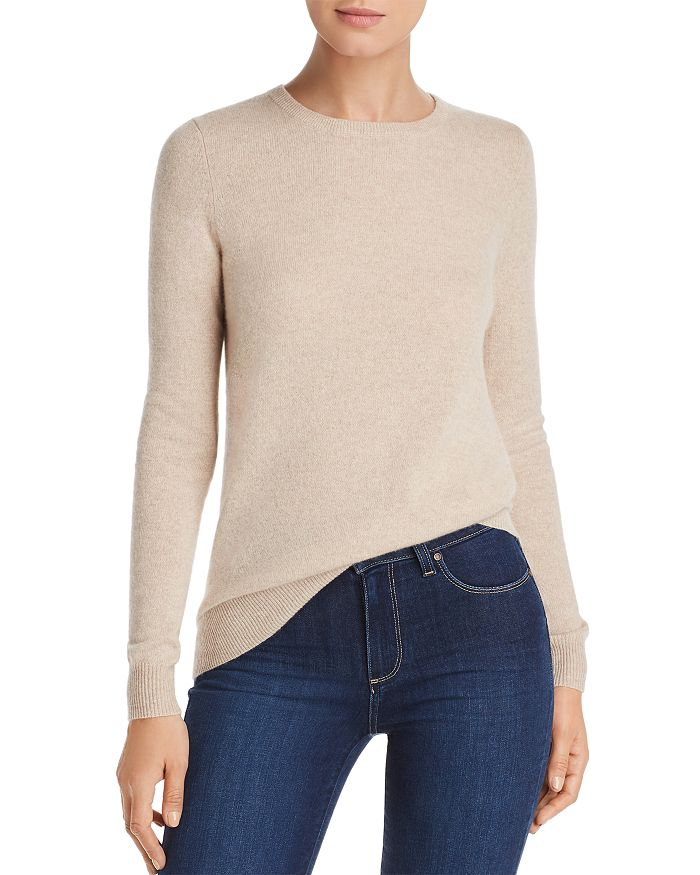 model wearing oatmeal colored crew neck sweater