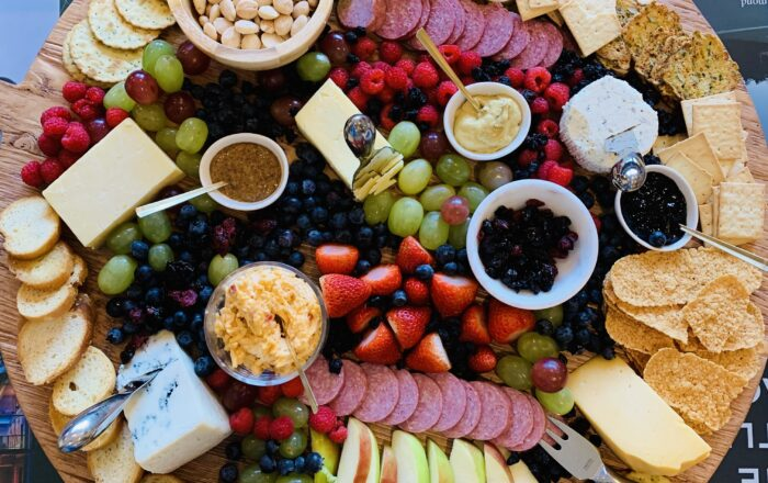 extra large cheese board with fruit nuts meats and cheese